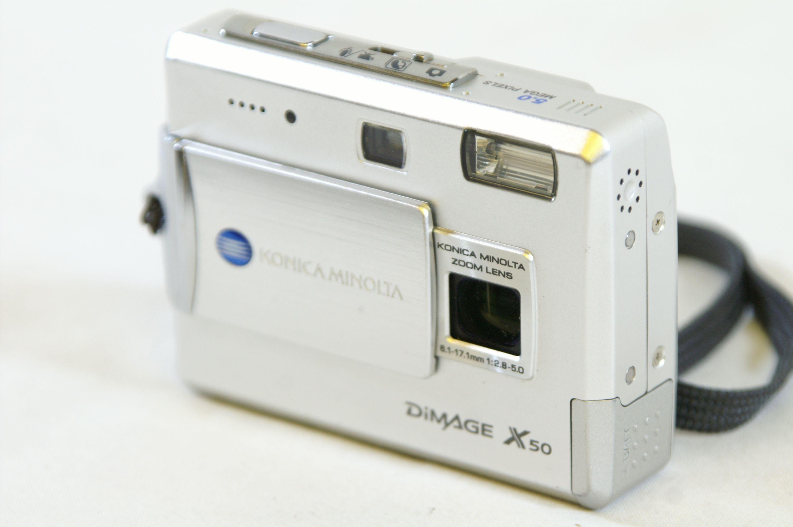 Konica Minolta Dimage X50 5.0MP Digital Camera with SD Card Bundle 2. Open  Full-Size Image