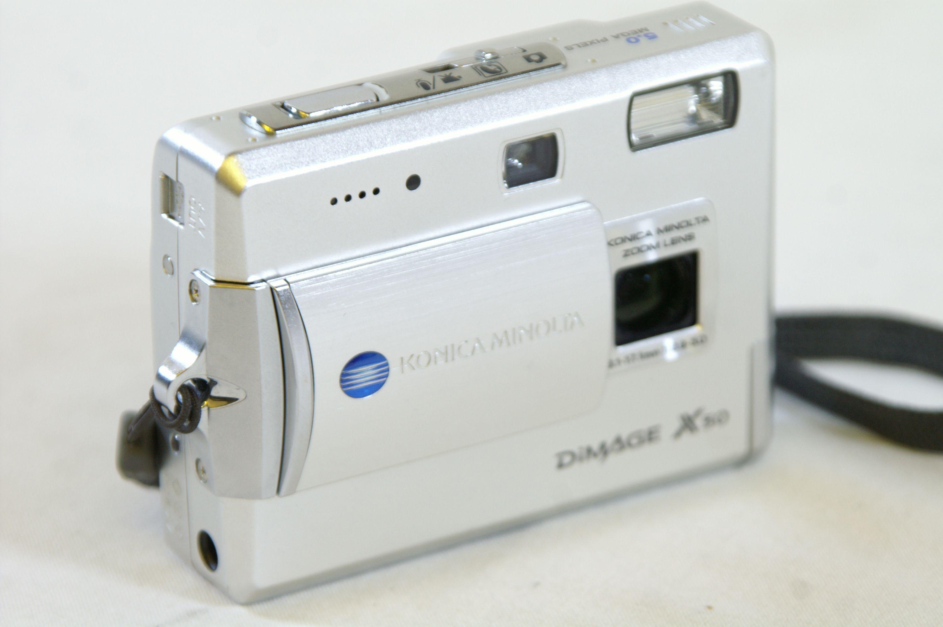 Konica Minolta Dimage X50 5.0MP Digital Camera with SD Card Bundle 3. Open  Full-Size Image