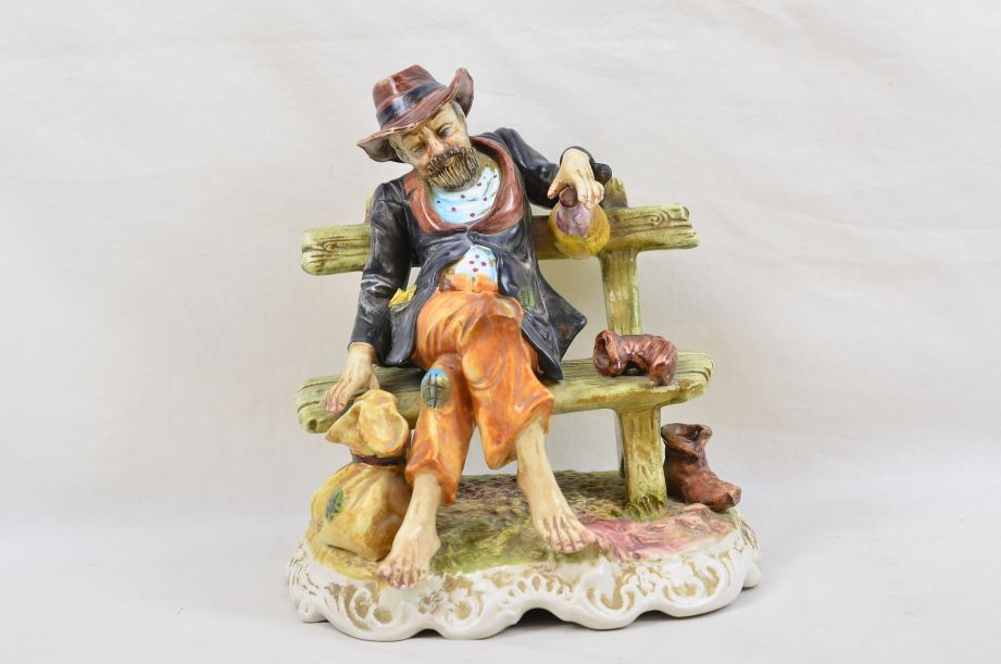 Large Capodimonte Tramp on Bench with Wine & Money Bag Figurine