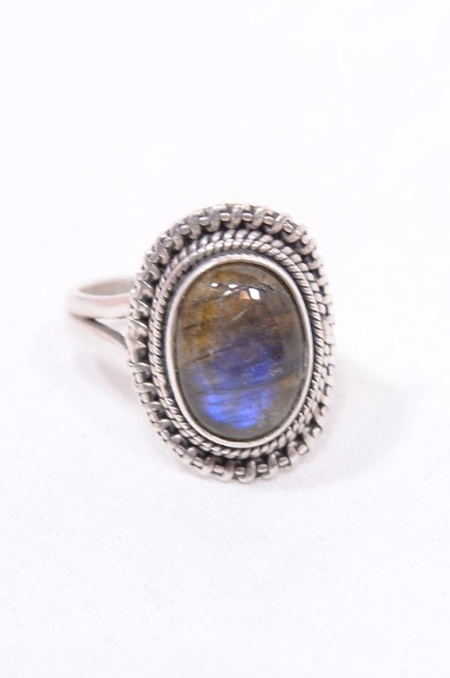 Sterling Silver Ring with a Blue Oval Gemstone 2