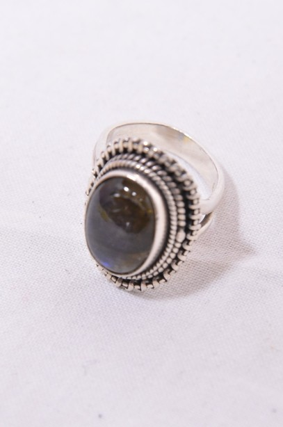 Sterling Silver Ring with a Blue Oval Gemstone 4
