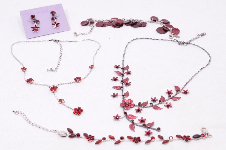 Box of assorted red stone jewellery